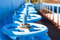 Close up of line from blue vents of gate valves Stock Photos