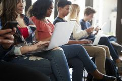 Close Up Of A Line Of High School Students Using Digital Devices stock image
