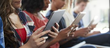 Close Up Of A Line Of High School Students Using Digital Tablets royalty free stock photography