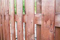 Close up of line light brown wooden fence.striped wooden fence background.vertical wooden fence wall. Stock Image