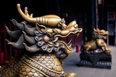Close up of lion bronze head statue. In a temple of China Stock Photography