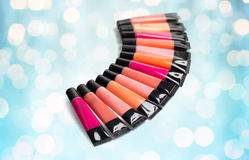 Close up of lip gloss tubes over blue lights Stock Photo