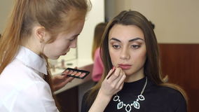 Close-up of lip makeup in the beauty salon. stock footage