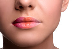 Close up lips shot of young woman posing, showing royalty free stock photo