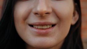 Close-up of the lips of a young woman smiling. stock video footage