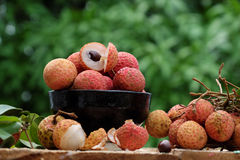 Close up of litchi fruit. Or lychee fruits, a tropical agriculture product at Luc Ngan, Bac Giang, Vietnam, basket of Vai thieu on green background Royalty Free Stock Images
