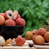 Close up of litchi fruit. Or lychee fruits, a tropical agriculture product at Luc Ngan, Bac Giang, Vietnam, basket of Vai thieu on green background Stock Image