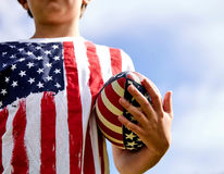 Close-up of little American rugby player with ball Stock Image