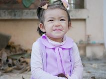 Close up of little Asian baby girl smiling as she is in a good mood stock photo
