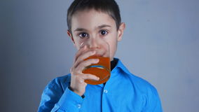 Close up of little boy drinks juice stock video