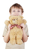 Close-up little boy holds bear-toy. Stock Photography