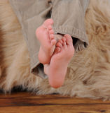 Close-up of little boys bare feet. Crossed over Royalty Free Stock Image