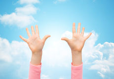 Close up of little child hands raised upwards Stock Photos