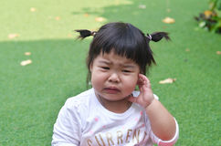 Close-up little girl crying in garden asian. Thailand Royalty Free Stock Images