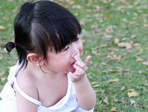 Close-up little girl crying in park.  Stock Photos