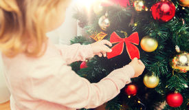 Close up of little girl decorating christmas tree Royalty Free Stock Images
