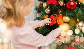 Close up of little girl decorating christmas tree Stock Images