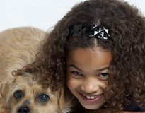 Close up of little girl with dog Royalty Free Stock Image