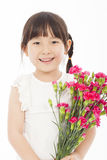 Close up of little girl holding  a bouquet of carnations Royalty Free Stock Photos