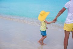 Close up of little girl holding her father hand on Stock Photo