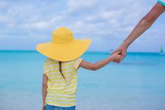 Close up of little girl holding her father hand on Royalty Free Stock Photography
