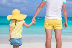 Close up of little girl holding her father hand on Stock Photos