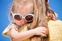 Close up of little girl hugging mom Royalty Free Stock Photos