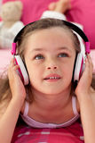 Close-up of a little girl listening music Stock Images