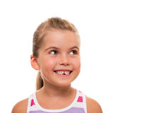Close up of little girl's face looking aside and smiling Royalty Free Stock Photography