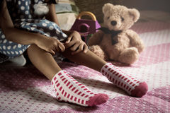 Close up a little girl 's legs wear socks Stock Image