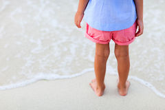 Close up of little girl standing at beach Royalty Free Stock Image