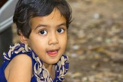 Close up of little Indian girl with her mouth open, Empress garden, Pune royalty free stock photos