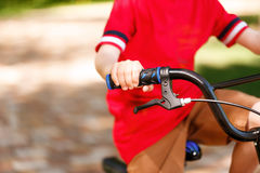 Close up of little kid riding bike Royalty Free Stock Photography