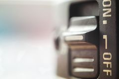 Close-up of little On/Off switch with soft blurred background Royalty Free Stock Image
