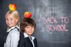 Close-up of little school boy and girl near Royalty Free Stock Photography