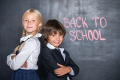 Close-up of little school boy and girl near Royalty Free Stock Photo