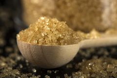Close up of little woode spoon filled with brown sugar Royalty Free Stock Photo