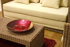 Close up living room. Close up of rattan table with red decoration dish stock photos
