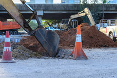 Close up of loader bucket working at construction site.  stock images