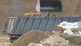 Close-up of loading sand in container. At huge sandpit stock video