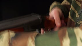 Close up of loading and unloading hunting rifle stock footage