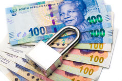 Close up of lock and money, isolated on the white Stock Photography