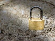 Close up lock on stone ground Stock Photos