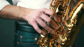 Close up locked down shot of jazz musician playing saxophone in studio. stock video footage