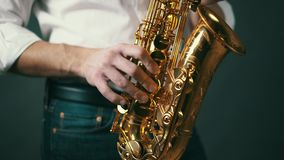 Close up locked down shot of musician playing saxophone in studio. stock video footage