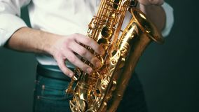 Close up locked down shot of musician playing saxophone in studio. stock video