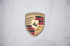 Close up of the logo of Porsche on the car front Stock Photos