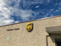 Close-up logo of UPS at entrance of Customer Centers in Dallas, stock photos