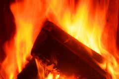 Close-up of burning firewood in a stove. Close-up of logs in a fire. Firewood is burning in a stove royalty free stock photography