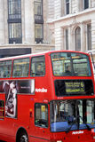 Close up London iconic double decker bus. London, UK – March 28 2014:   Close up picture of Iconic double decker red bus taken at Regent Street in the West End Royalty Free Stock Photos